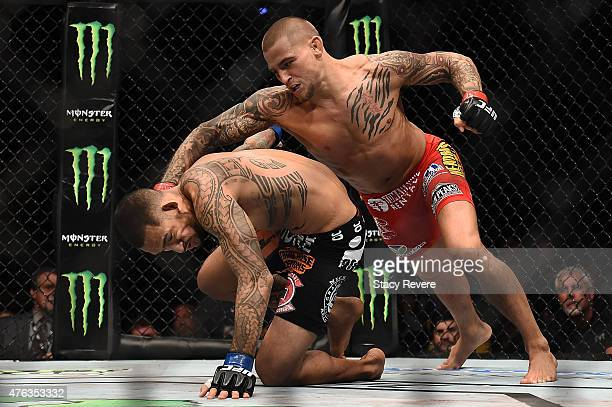 Dustin Poirier punches Yancy Medeiros in their lightweight bout during the UFC Fight Night event at Smoothie King Center on June 6 2015 in New...