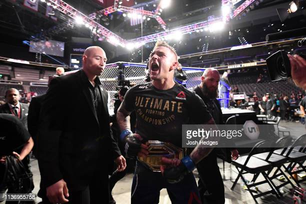 Dustin Poirier reacts after defeating Max Holloway in their interim lightweight championship bout during the UFC 236 event at State Farm Arena on...