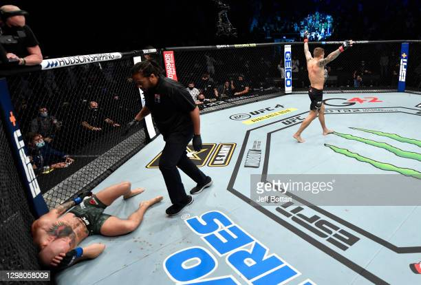 Dustin Poirier reacts after his knockout victory over Conor McGregor of Ireland in a lightweight fight during the UFC 257 event inside Etihad Arena...
