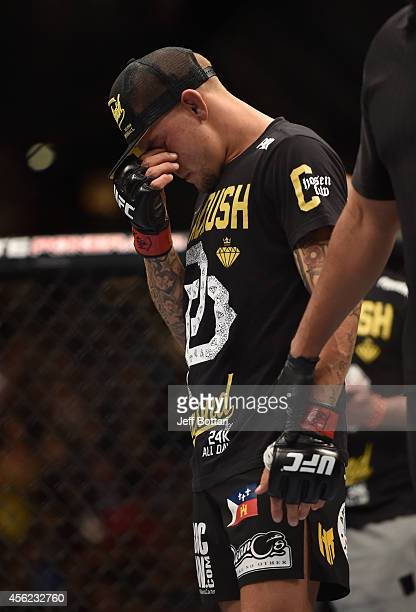 Dustin Poirier reacts to his TKO loss to Conor McGregor in their featherweight fight with during the UFC 178 event inside the MGM Grand Garden Arena...