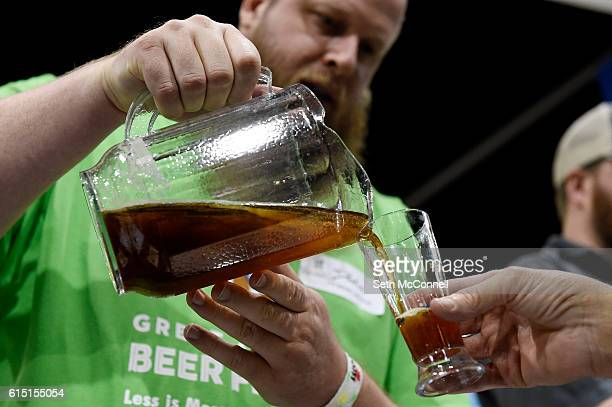 Dustin Powers pours the Red Irish Hart for an attendee at Castle Rock Beer Company's booth during the Great American Beer Festival at the Colorado...