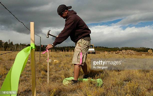 OCT 03 2006 Dustin Stevens <CQ> works Tuesday Oct 03 on marking out a silt fence around a new development called Stone River Ranch in Fairplay Stone...