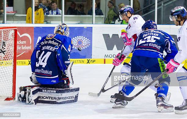 Dustin Strahlmeier of Straubing Tigers and Spencer Machacek of the Eisbaeren Berlin during the game between the Straubing Tigers and the Eisbaeren...