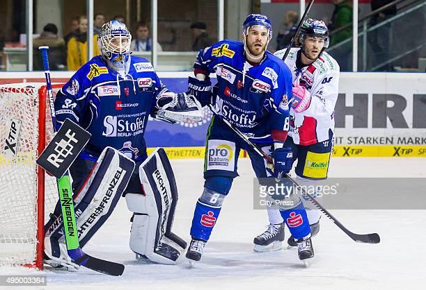 Dustin Strahlmeier Sebastian Osterloh of Straubing Tigers and Julian Talbot of the Eisbaeren Berlin during the game between the Straubing Tigers and...