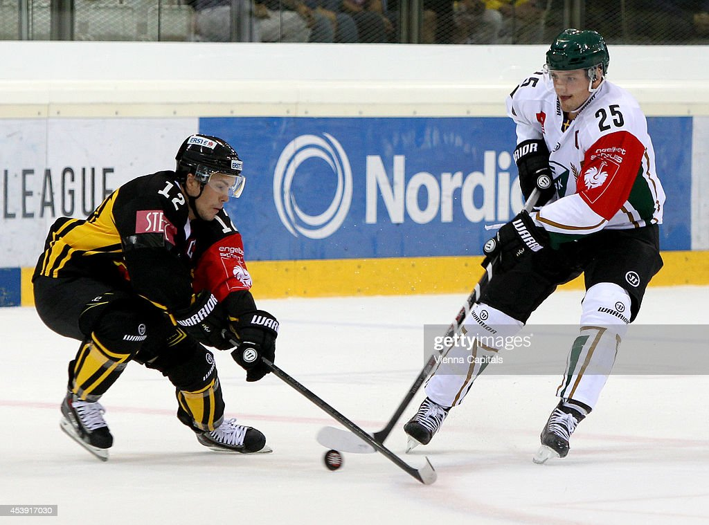Dustin Sylvester (Capitals) and Anton Hedman (Faerjestad) in action during the Champions Hockey League group stage game between Vienna Capitals and Faerjestad Karlstad on August 21, 2014 in Vienna, Austria.