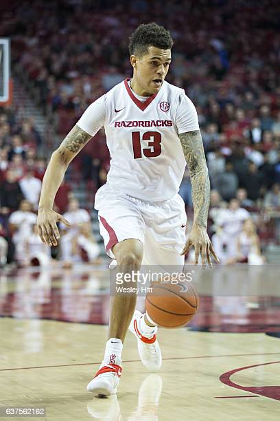 Dustin Thomas of the Arkansas Razorbacks dribbles down the court during a game against the Florida Gators at Bud Walton Arena on December 29 2016 in...