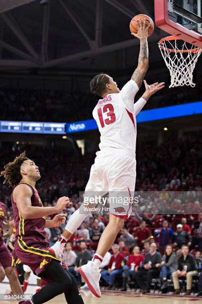 Dustin Thomas of the Arkansas Razorbacks goes up for a layup during a game against the Minnesota Golden Gophers at Bud Walton Arena on December 9...