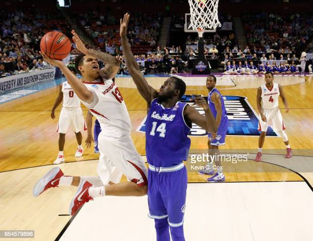 Dustin Thomas of the Arkansas Razorbacks goes up for a shot against Ismael Sanogo of the Seton Hall Pirates in the first round of the 2017 NCAA Men's...