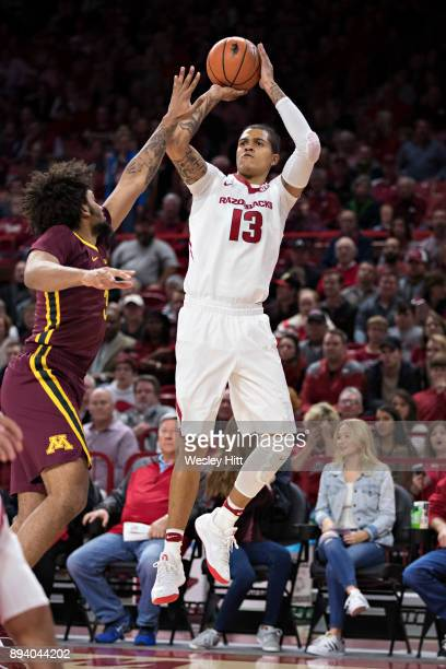 Dustin Thomas of the Arkansas Razorbacks shoots a jump shot during a game against the Minnesota Golden Gophers at Bud Walton Arena on December 9 2017...
