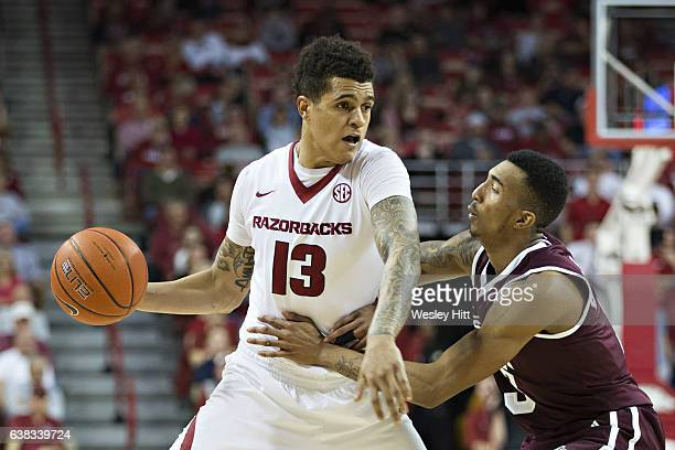 Dustin Thomas of the Arkansas Razorbacks with the ball being defended by Xavian Stapleton of the Mississippi State Bulldogs at Bud Walton Arena on...