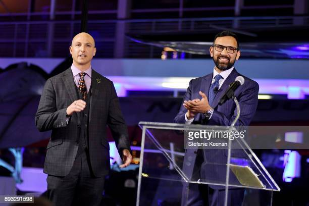 Dustin Tillman and Zeeshawn Zia speak onstage during Elite Aerospace Group's 4th Annual Aerospace Defense Symposium at Lyon Air Museum on December 14...
