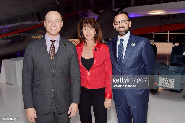 Dustin Tillman Zeeshawn Zia and guest attend Elite Aerospace Group's 4th Annual Aerospace Defense Symposium at Lyon Air Museum on December 14 2017 in...