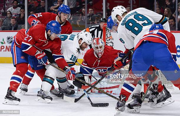 Dustin Tokarski Alex Galchenyuk and Alexei Emelin of the Montreal Canadiens defend the goal against Mike Brown and Barclay Goodrow of the San Jose...