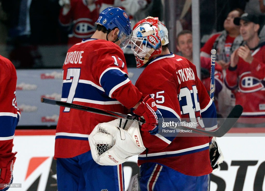 Dustin Tokarski #35 and Rene Bourque #17 of the Montreal Canadiens celebrates after defeating the New York Rangers during Game Five of the Eastern Conference Final in the 2014 NHL Stanley Cup Playoffs at Bell Centre on May 27, 2014 in Montreal, Canada. Canadiens defeated the Rangers 7-4.