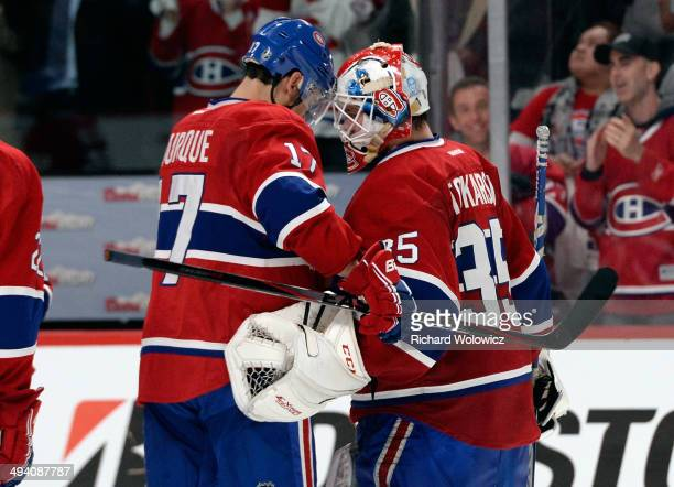 Dustin Tokarski and Rene Bourque of the Montreal Canadiens celebrates after defeating the New York Rangers during Game Five of the Eastern Conference...