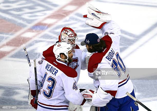 Dustin Tokarski of the Montreal Canadiens celebrate with teammates Peter Budaj and Mike Weaver after defeating the New York Rangers in overtime...