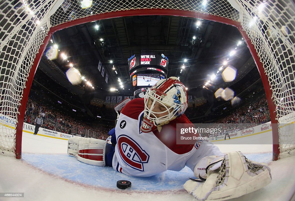 Dustin Tokarski #35 of the Montreal Canadiens lies on the ice following a shootout goal by Patrik Elias #26 of the New Jersey Devils at the Prudential Center on April 3, 2015 in Newark, New Jersey. The Devils defeated the Canadiens 3-2 in the shootout.