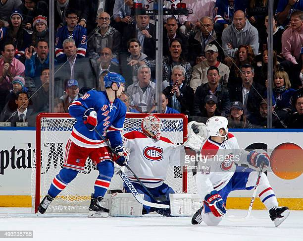 Dustin Tokarski of the Montreal Canadiens makes a glove save in the second period of Game Three of the Eastern Conference Final against the New York...