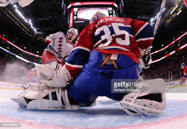 Dustin Tokarski of the Montreal Canadiens makes a save against Chris Kreider of the New York Rangers in the second period during Game Five of the...