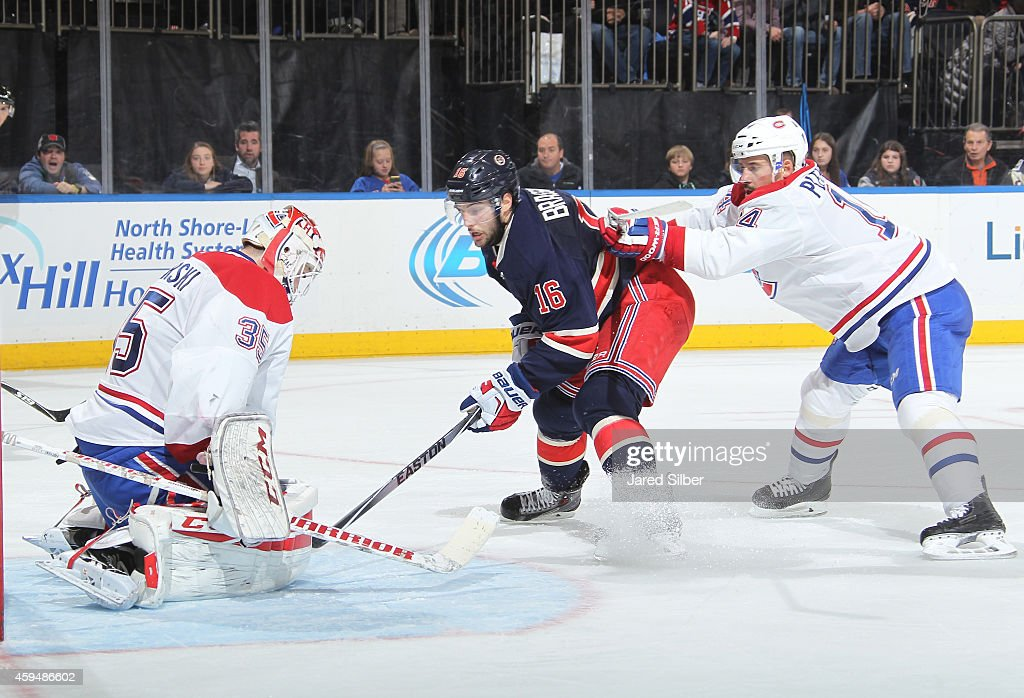 Dustin Tokarski #35 of the Montreal Canadiens makes a save against Derick Brassard #16 of the New York Rangers at Madison Square Garden on November 23, 2014 in New York City.