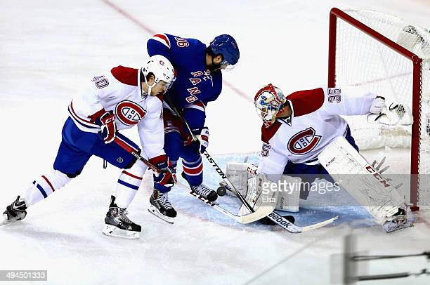 Dustin Tokarski of the Montreal Canadiens makes a save against Derick Brassard of the New York Rangers during Game Six of the Eastern Conference...