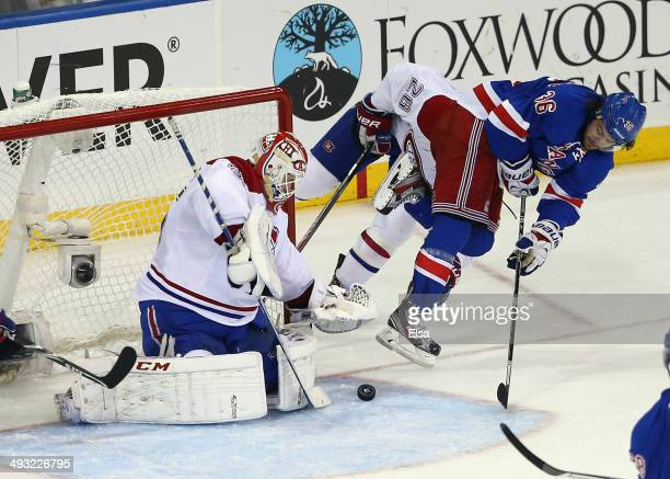 Dustin Tokarski of the Montreal Canadiens makes a save against Mats Zuccarello of the New York Rangers in Game Three of the Eastern Conference Final...