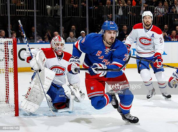 Dustin Tokarski of the Montreal Canadiens watches Chris Kreider of the New York Rangers as he skates after the puck in the first period of Game Six...