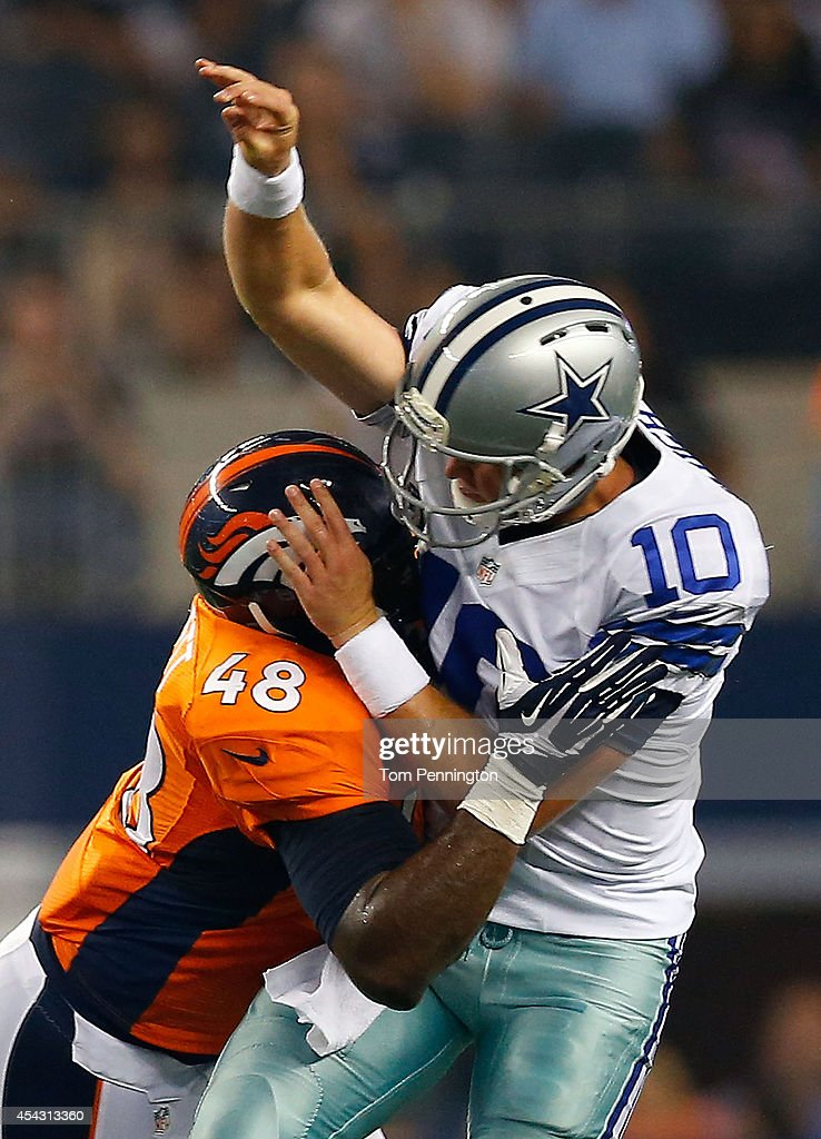 Dustin Vaughan #10 of the Dallas Cowboys is hit by Shaquil Barrett #48 of the Denver Broncos in the second half of their preseason game at AT&T Stadium on August 28, 2014 in Arlington, Texas.