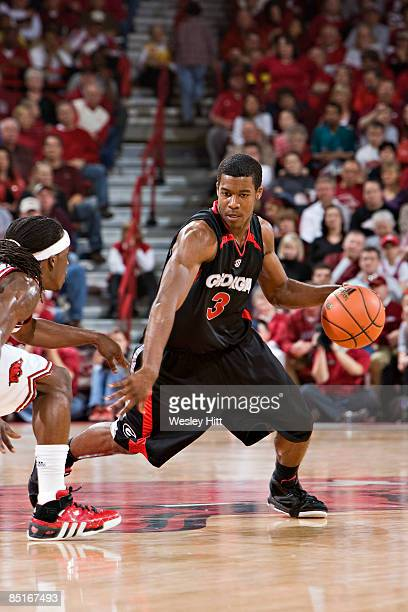 Dustin Ware of the Georgia Bulldogs dribbles the ball out front during a game against the Arkansas Razorbacks at Bud Walton Arena on March 1, 2009 in...