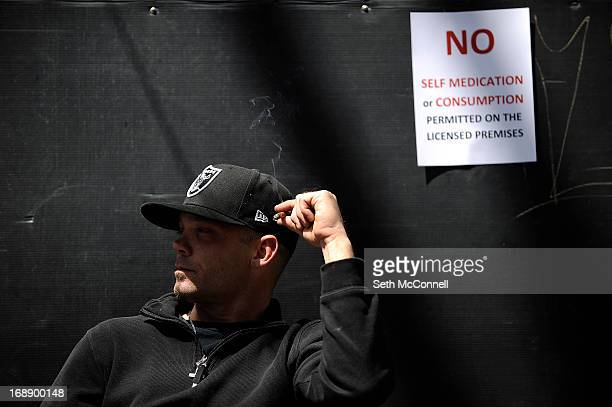 Dustin Zimmerman from Denver Colorado smokes a blunt as he relaxes outside during the High Times US Cannabis Cup at the Exdo Center on April 21 2013...