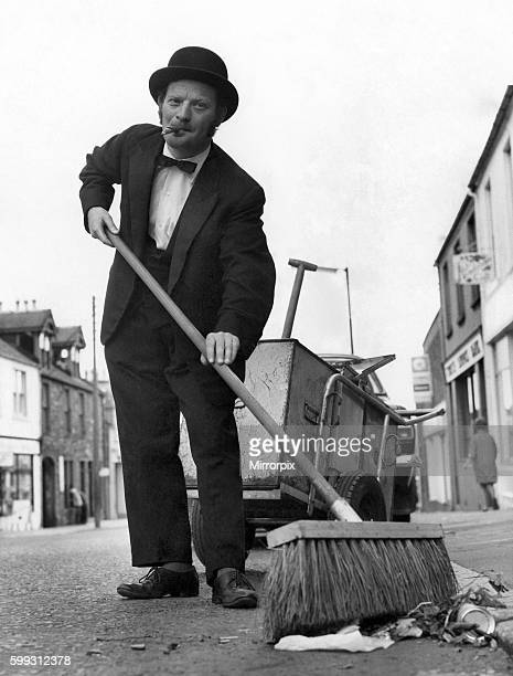 Dustman Sam McKill is dressed to kill as he goes on his daily rounds With natty bowler dinner suit and black bow tie he sweeps the girls off their...