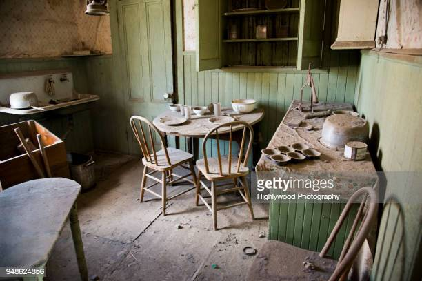 a dusty, abandoned kitchen in bodie ghost town - highlywood stock pictures, royalty-free photos & images