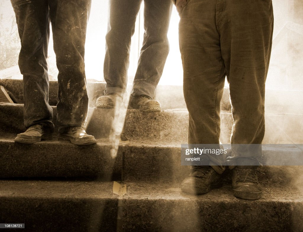 Dusty and Feet at a Construction Site : Stock Photo