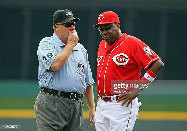 Dusty Baker and umpire Gary Cederstrom talk about a play during the game against the Washington Nationals at Great American Ball Park on July 22,...