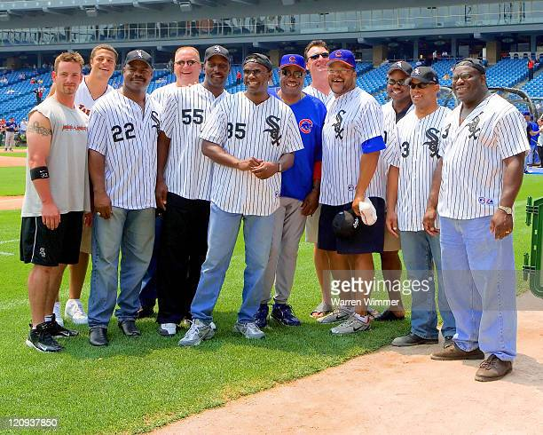 Dusty Baker joins Aaron Rowand of the White Sox and some of the 1985 Chicago Bears at US Cellular Field on June 26 2005 in Chicago Illinois