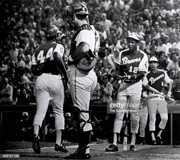 Dusty Baker of the Atlanta Braves congratulates teammate Hank Aaron after Aaron's 703rd home run