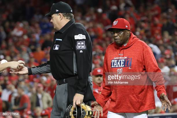 Dusty Baker of the Washington Nationals argues with umpire Jerry Layne during the fifth inning in game five of the National League Division Series at...