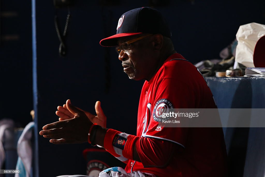 Dusty Baker #12 of the Washington Nationals in the dugout during the game against the Atlanta Braves at Turner Field on August 20, 2016 in Atlanta, Georgia.