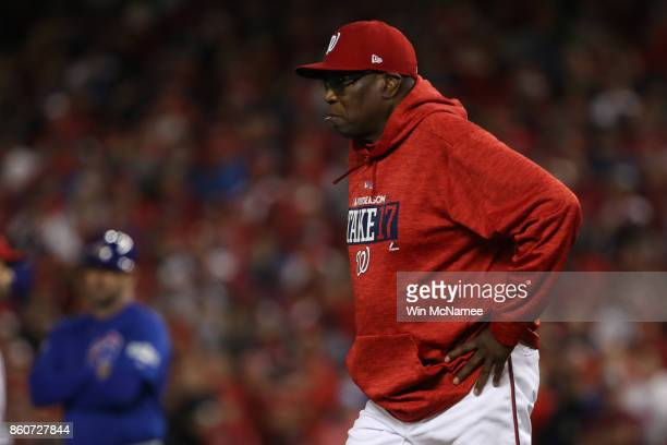 Dusty Baker of the Washington Nationals looks on against the Chicago Cubs during the fifth inning in game five of the National League Division Series...