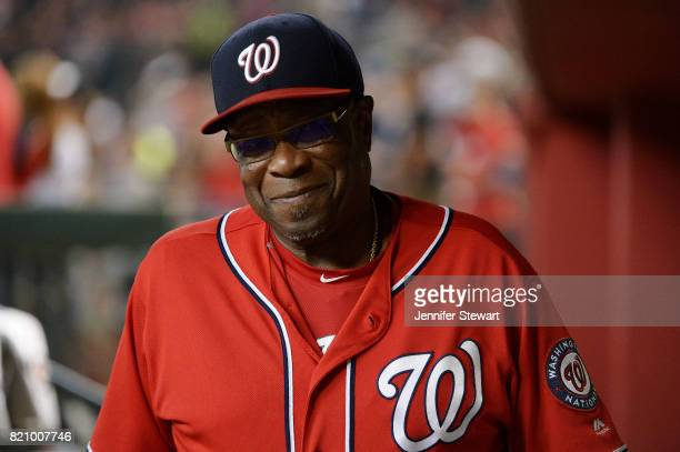 Dusty Baker of the Washington Nationals smiles while walking through the dugout prior to the MLB game against the Arizona Diamondbacks at Chase Field...