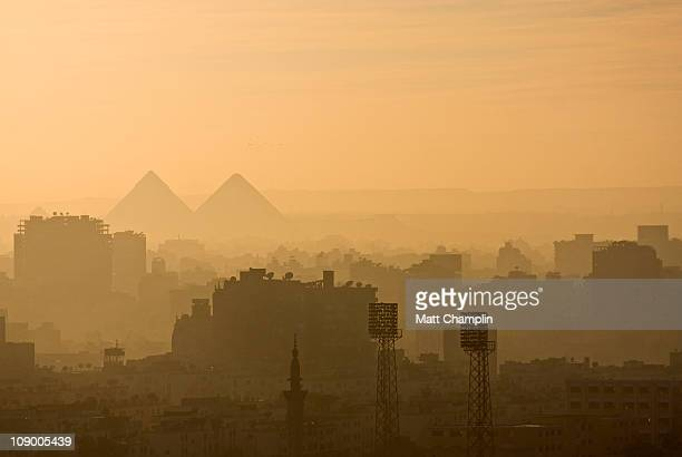 Dusty Cairo Cityscape and Pyramids