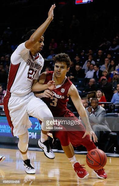 Dusty Hannahs of the Arkansas Razorbacks drives against Cameron Walker of the Stanford Cardinal at Barclays Center on November 27 2015 in Brooklyn...