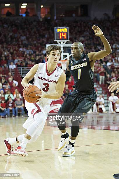 Dusty Hannahs of the Arkansas Razorbacks drives past Terrence Phillips of the Missouri Tigers at Bud Walton Arena on January 14 2017 in Fayetteville...