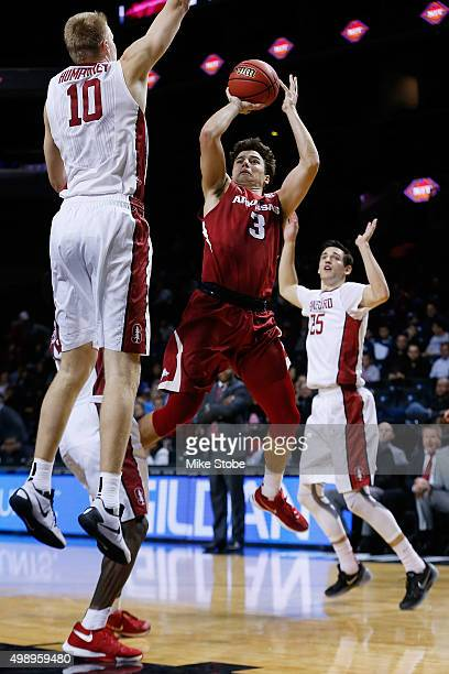 Dusty Hannahs of the Arkansas Razorbacks drives to the basket against Michael Humphrey of the Stanford Cardinal at Barclays Center on November 27...