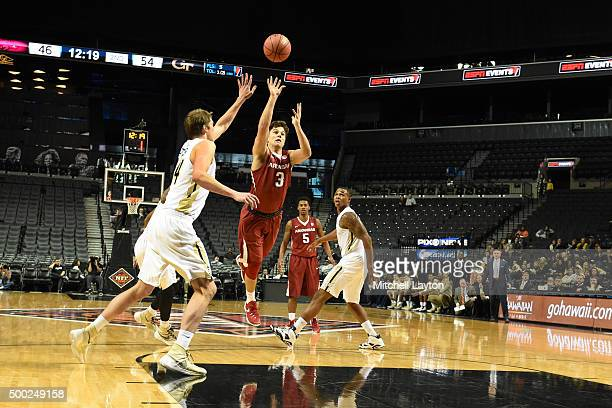 Dusty Hannahs of the Arkansas Razorbacks drives to the basket during game on of the NIT Season TipOff college basketball tournament at Barclays...