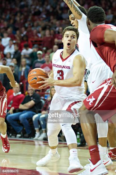 Dusty Hannahs of the Arkansas Razorbacks goes around his own teammate on the way to the basket against the Alabama Crimson Tide at Bud Walton Arena...