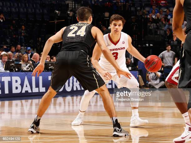 Dusty Hannahs of the Arkansas Razorbacks plays in SEC Tournament Semifinal game against Vanderbilt at Bridgestone Arena on March 11 2017 in Nashville...