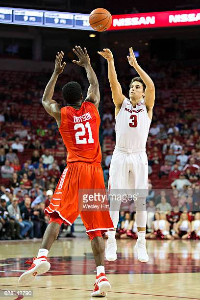 Dusty Hannahs of the Arkansas Razorbacks shoots a three point jump shot during a game against the Houston Cougars at Bud Walton Arena on December 6...