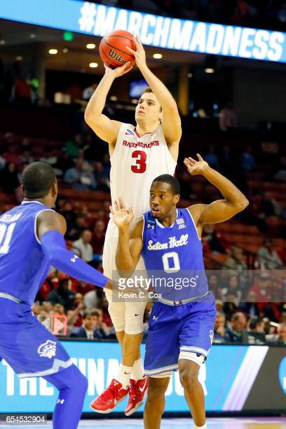 Dusty Hannahs of the Arkansas Razorbacks shoots over Khadeen Carrington of the Seton Hall Pirates in the first half in the first round of the 2017...