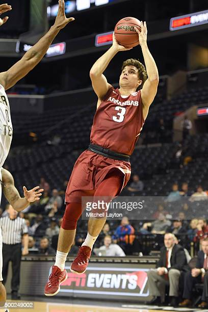 Dusty Hannahs of the Arkansas Razorbacks takes a jump shot during game on of the NIT Season TipOff college basketball tournament at Barclays Center...